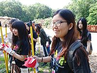 Giving back: CCIP exchange visitors volunteer at Cunningham Park